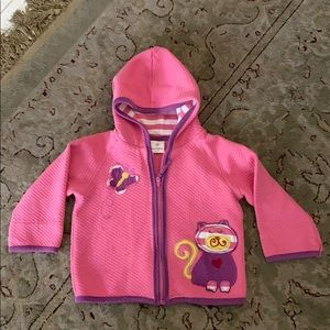 Pink hoodie with butterfly and cat appliqué.
